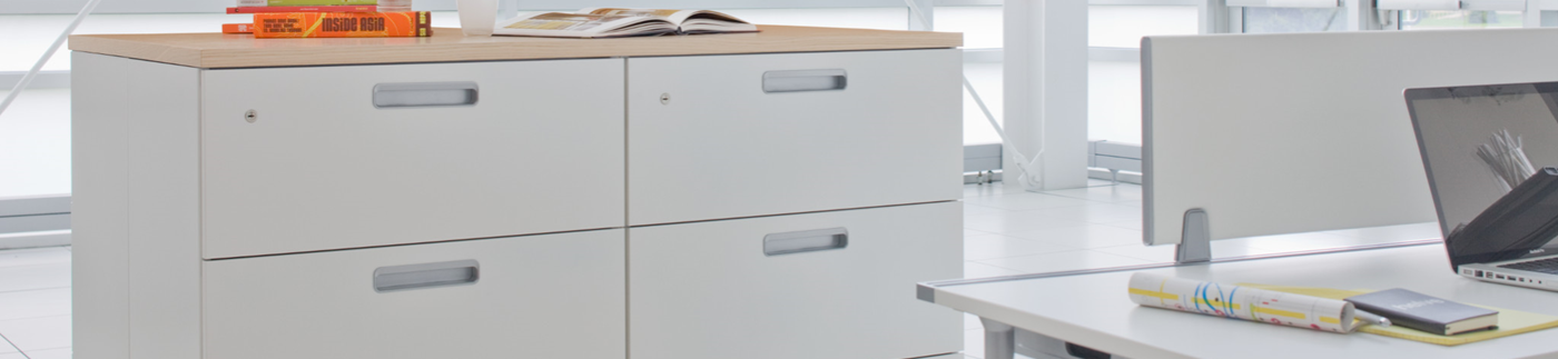 Two Storage Filing Cabinets Next to Workstation