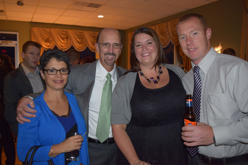 Staff members Denise Burgio, Darby Walsh, Amy Johnson and husband Gary Johnson
