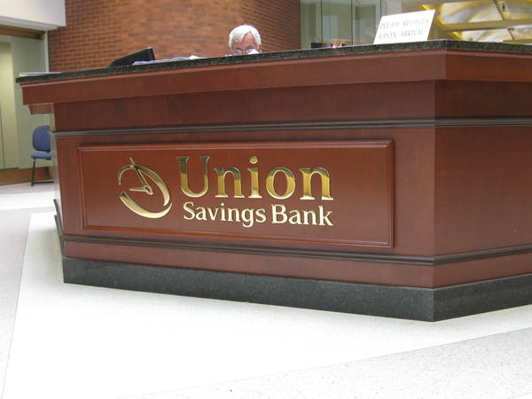 "Interior Reception Area Lobby Sign,1/4"" Polished Brass Letters on Reception Desk"
