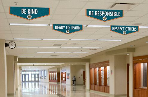 Custom Banners in school hallway entrance, character values, be kind, aqua and orange, school banners