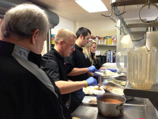 BIRMINGHAM BARONS FRONT OFFICE STAFF SERVES LUNCH AT THE SHELTER