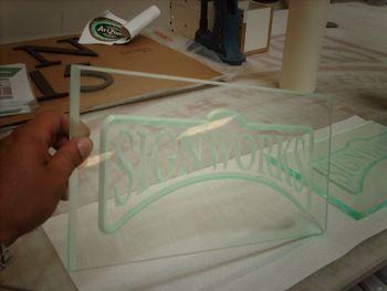 Reverse engrave on unique materials
