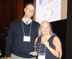 Mark Dunning and Moira Shea are shown presenting the award in honor of Barney Skladany, Jr. (Barney not pictured.)
