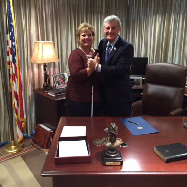 Picture of Danay and Mississippi's Governor Phil Bryant.