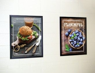 2 food image posters in frames on a wall, school signs, nutrition education, market café