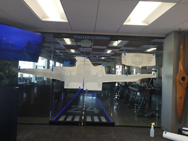 Installing window graphics for restaurants in Fullerton CA