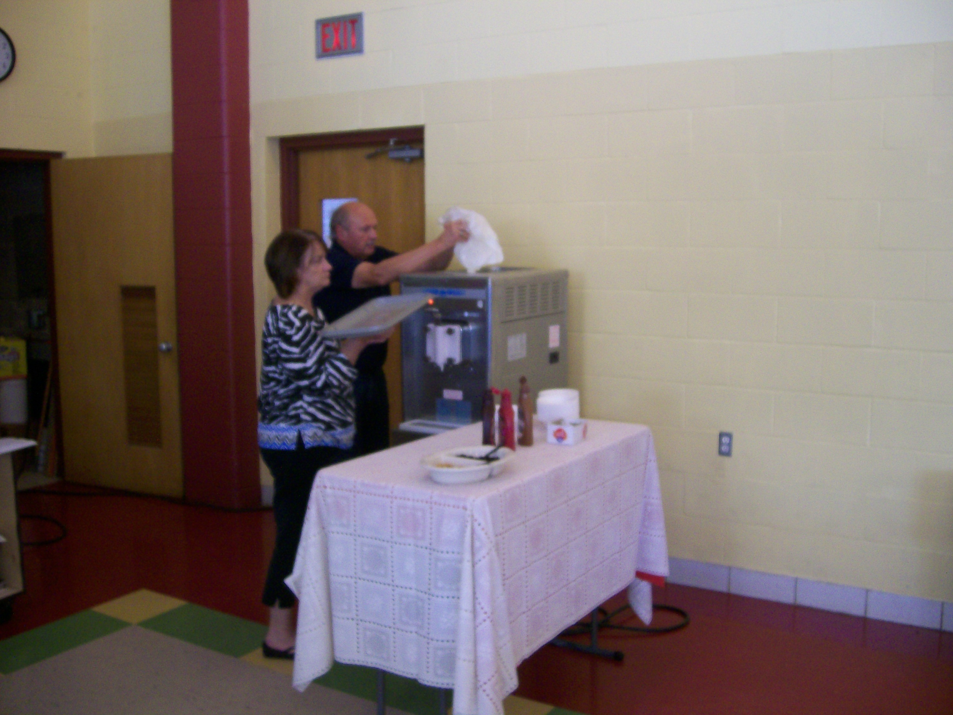 Volunteers filling the Soft Serve Ice Cream Machine - Yum Yum