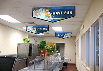 Elementary school café serving line with 3 fun banners hanging above, school banners, fitness characters