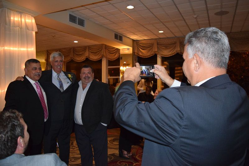 Anthony Perito taking a photo of Luis Alvarez, Greg Goldstein and Joe Perrello