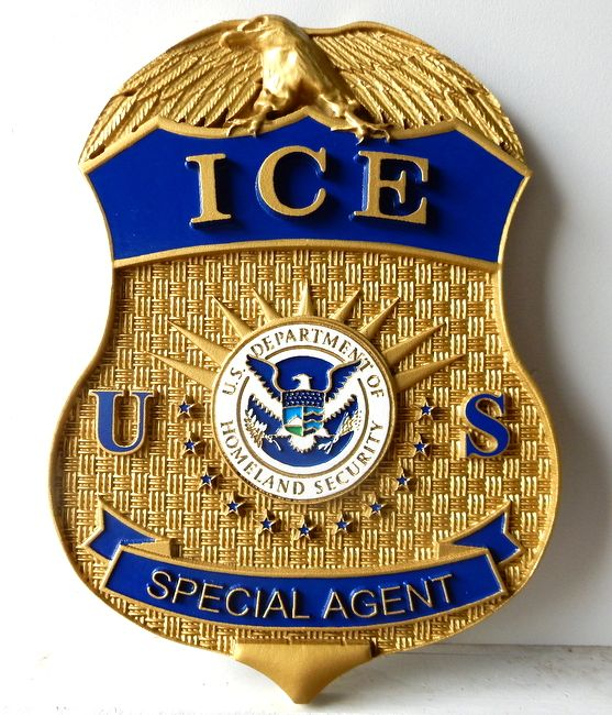 X33605 - Metallic Gold Painted Plaque of the Badge of ICE, with an eagle and the Homeland Security seal