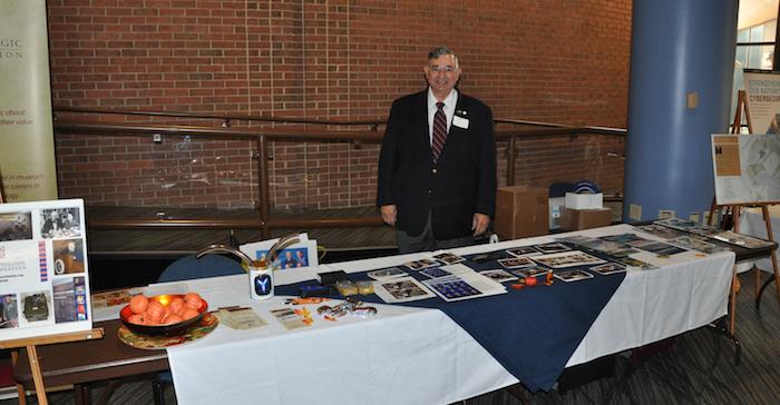 John Garcia mans the NCMF/NCM table in the lobby.
