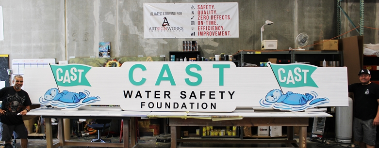 S28139= Large Carved and Sandblasted Wood Grain Sign for the the Cast Water Safety Foundation, with Otter Logo as Artwork