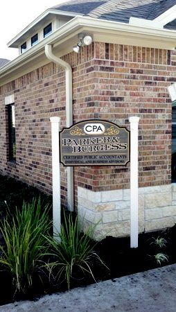 C12005 - CPA Sign Installed with Wood Posts outside Building