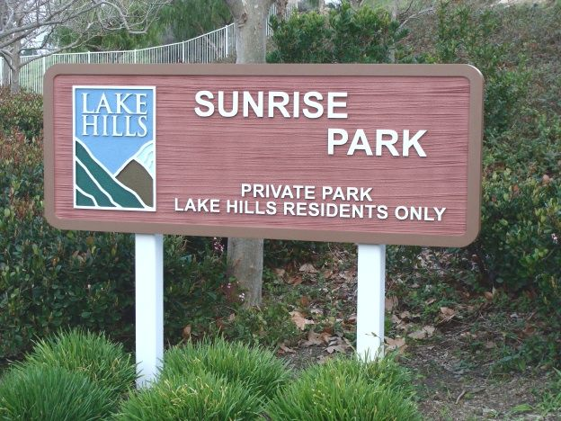 GA16452 - Post Mounted, Carved HDU Sign featuring  Lake and Mountain Artwork,  for a Private Park for Community Residents