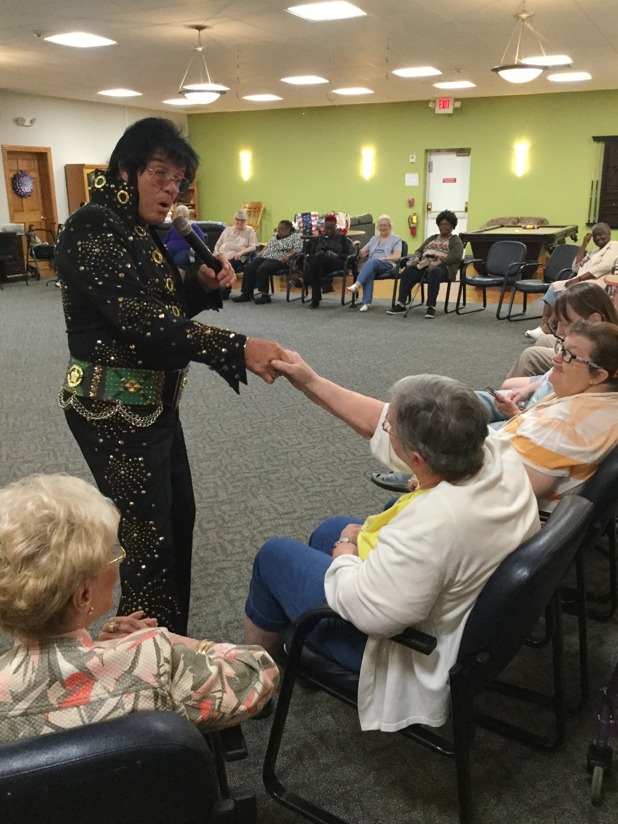 Elvis serenades our Adult Day Center member Peggy
