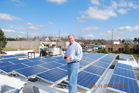 Solar Panel Photo with Darrel Standing