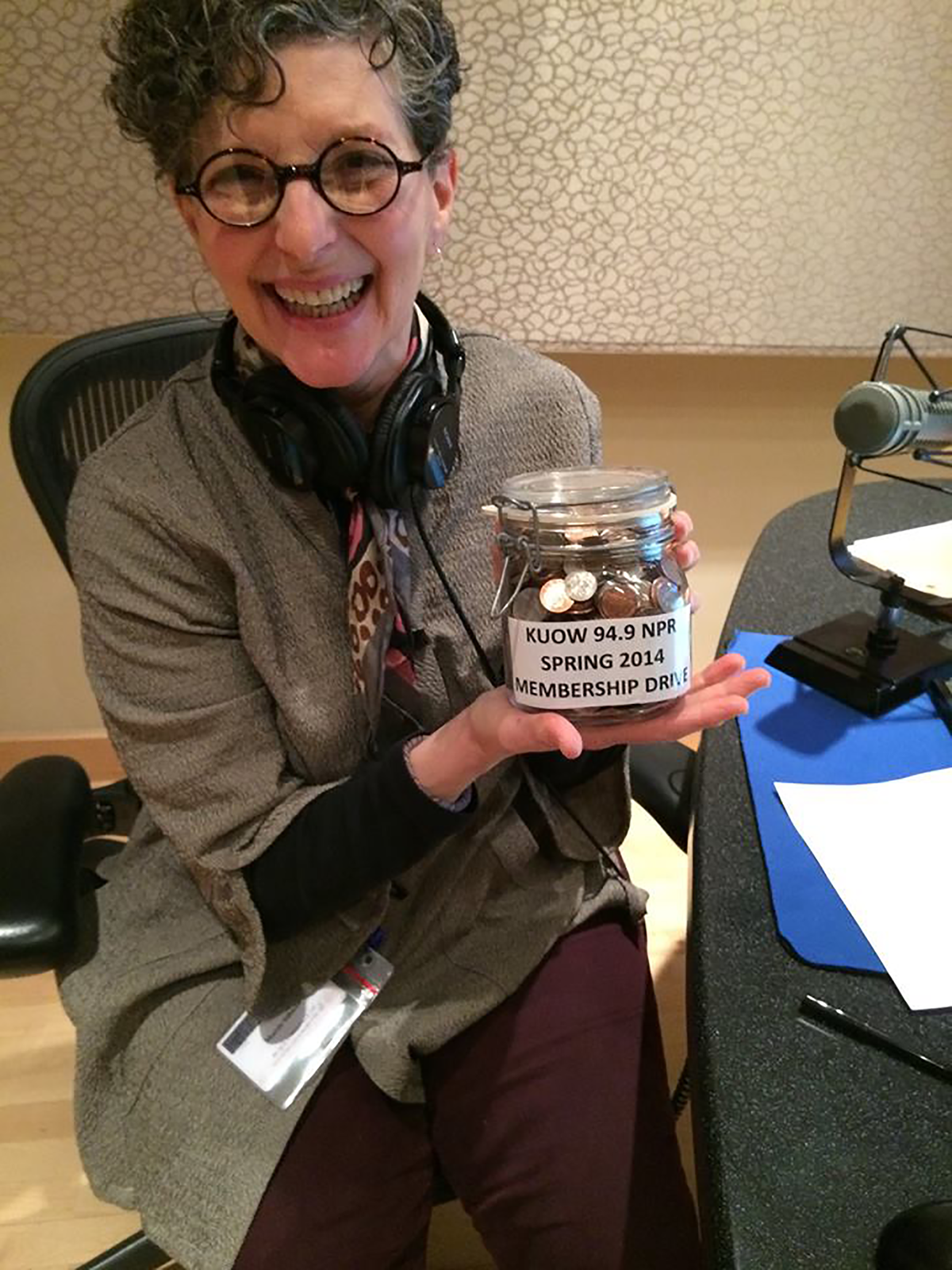 Marcie Sillman with money from the KUOW Membership Drive, 2014.