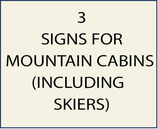 3. Signs for Mountains Cabins, including Skiers