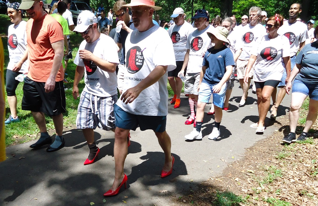 Walk a Mile in Her Shoes, an annual walk where male participants walk a mile in high heels to raise awareness about the causes and effects to men's violence against women.