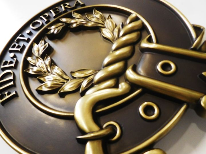 M7159 - Carved 3D Brass Wall Plaque of the Emblem of a Large Church.
