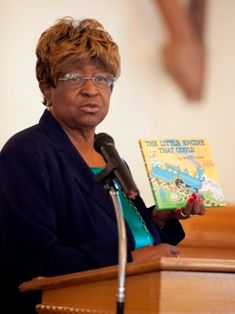 Rep. Barbara Boyd reads from The Little Engine That Could.