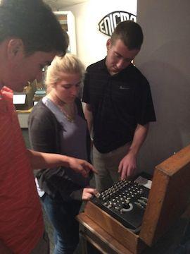 Students use Enigma machine