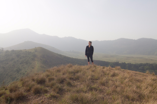 Photo of Rachel in Cameroon overlooking mountains and hillsides