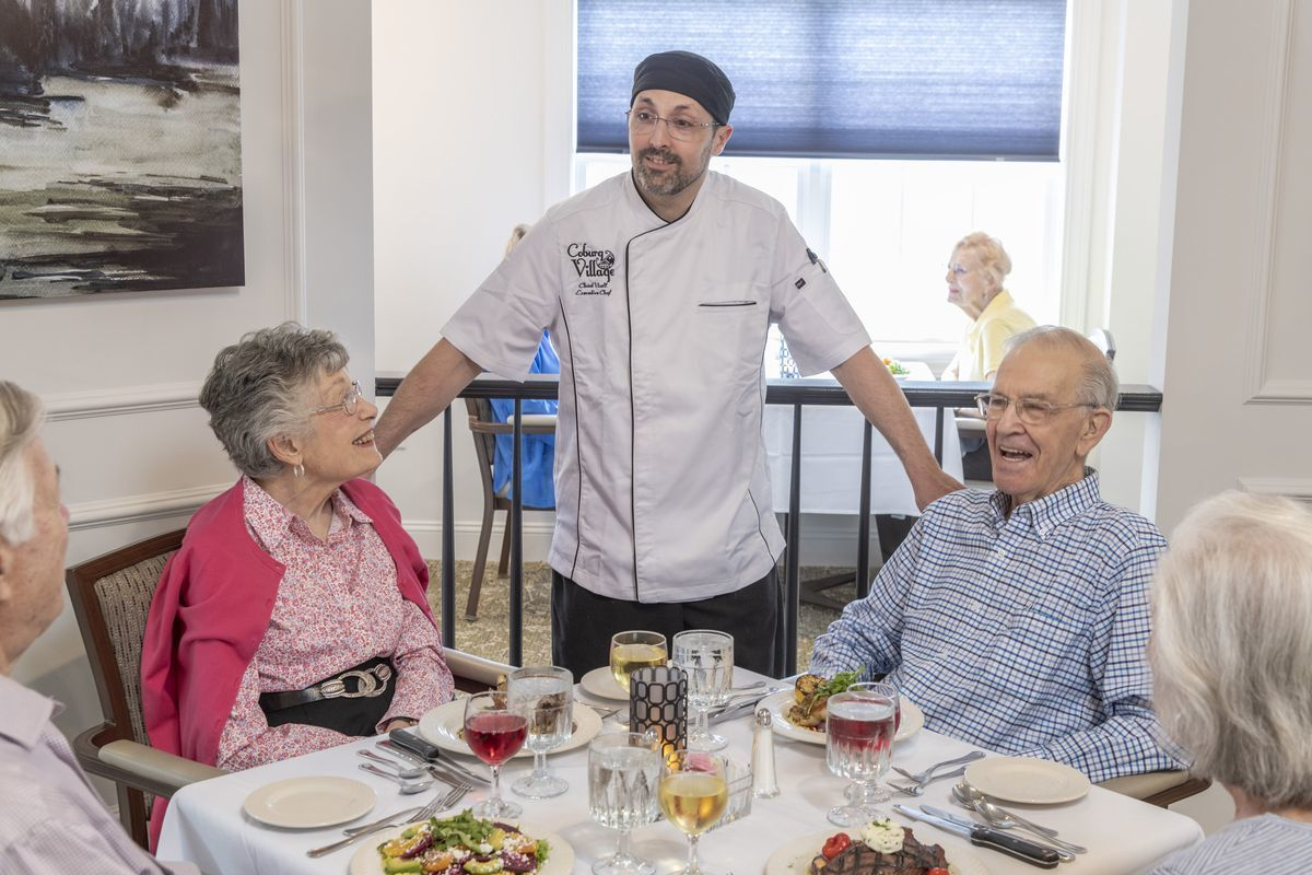 Chef talking with residents in the dining room