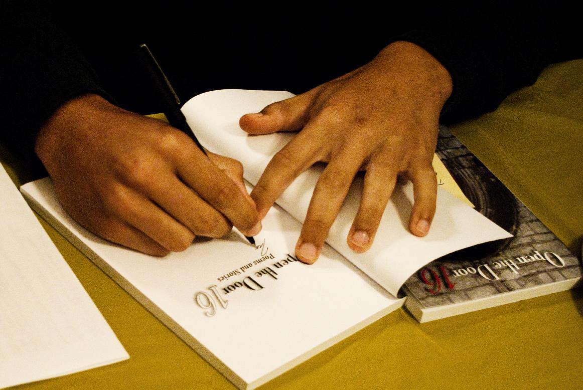 Student writer autographs book