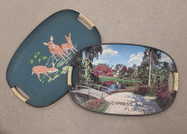 Two vintage drink trays found at a local Goodwill store.