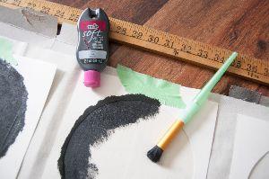Black paint on crescent moon stencils.