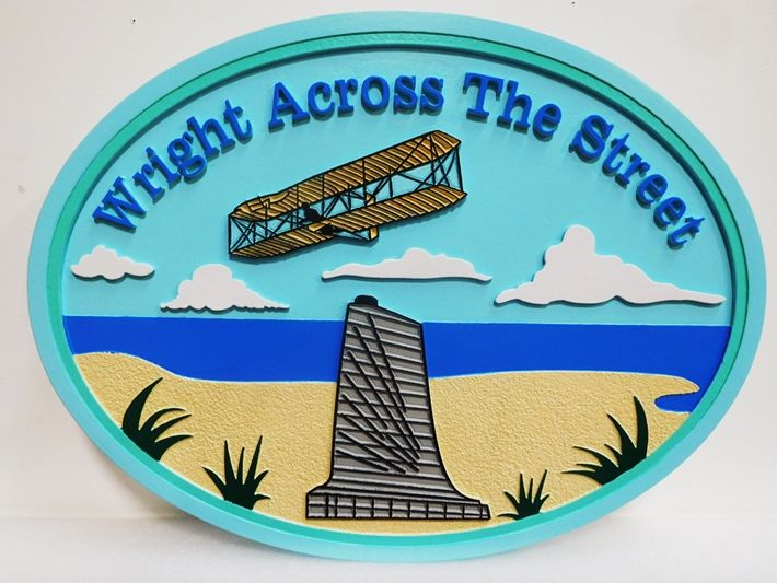 """L21945 - Carved and Sandblasted 2.5-D HDU sign for the """"Wright Across the Street"""" Beach House, featuring the Wright Brothers First Aircraft, the Monument and Beach as Artwork"""
