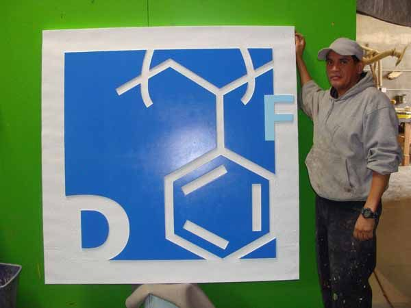 N23223-  Carved and Sandblasted 3-D High-Density-Urethane (HDU)  Wall Plaque Featuring  a Stylized Logo