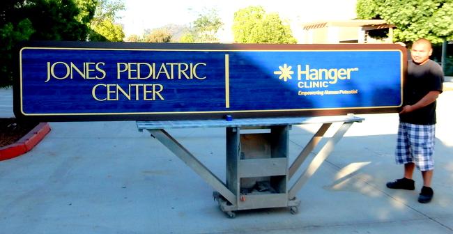B11009 - Pediatric Center Woodgrain-Look, Sandblasted HDU Sign with Gold-Metallic Text and Trim
