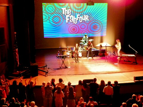 Fab Four Takes Beatles Fans Back To Their Youth  In Support Of Crossroads Community