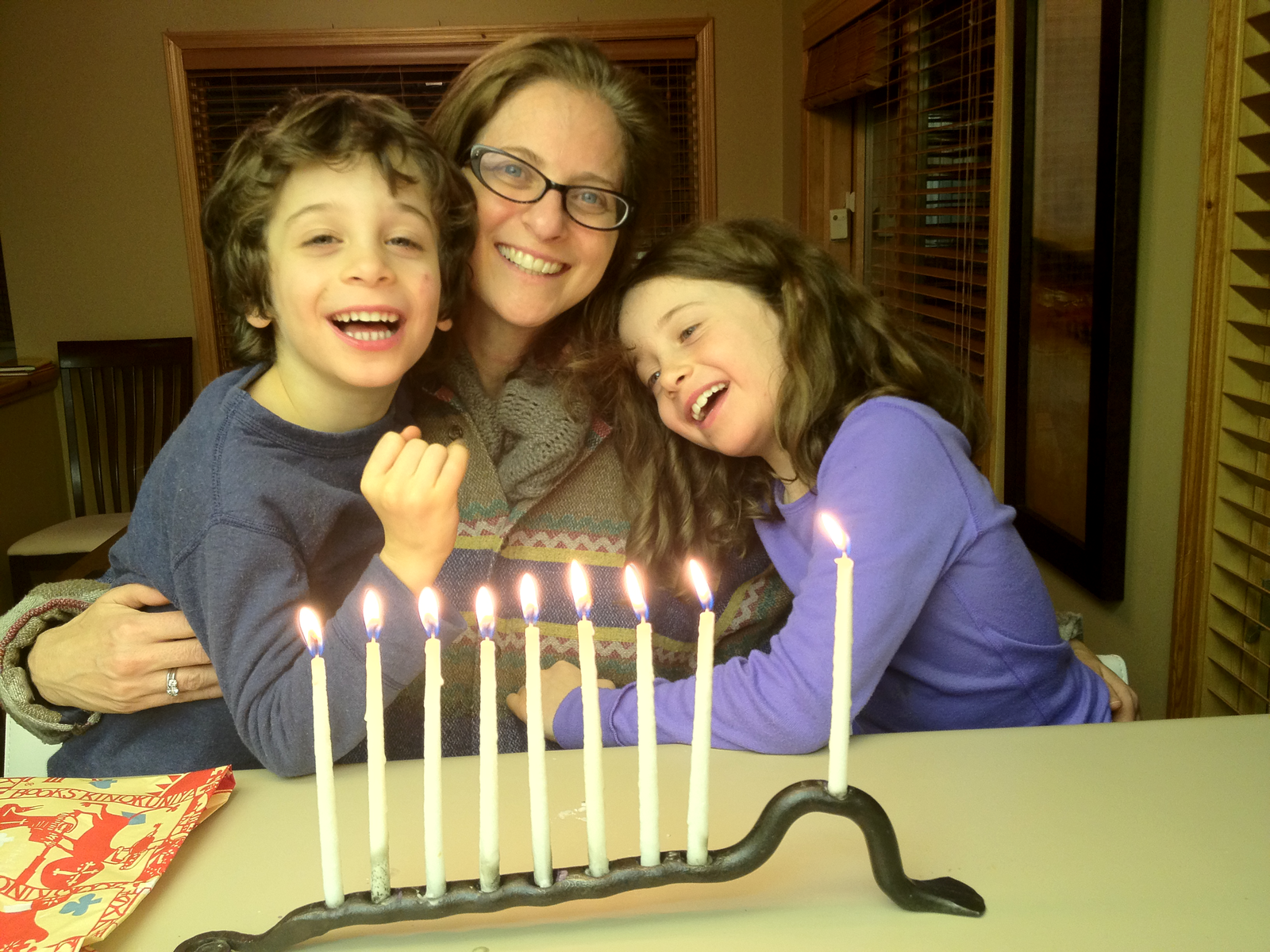 Michelle and her children on the 8th night of Chanukah.