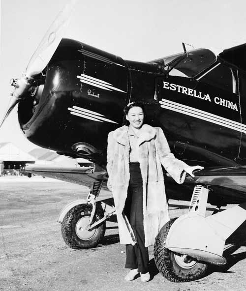 Lee Ya-Ching with Beechcraft ' Estrella China', on her Goodwill Tour, Roosevelt Field, L.I. 1940 (Cradle of Aviation Museum)