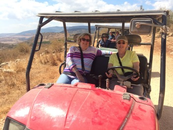 Lynn and with her sister, driving a dune buggy in Israel