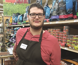 Young man working in pet store
