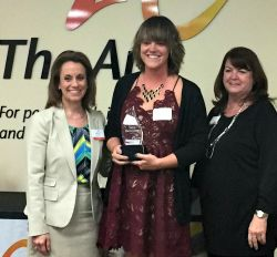 Sara receives her award from Lori Roper from The Arc of Jefferson, Clear Creek and Gilpin Counties