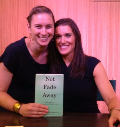 Caroline and Rebecca at book signing. The book is titled Not Fade Away