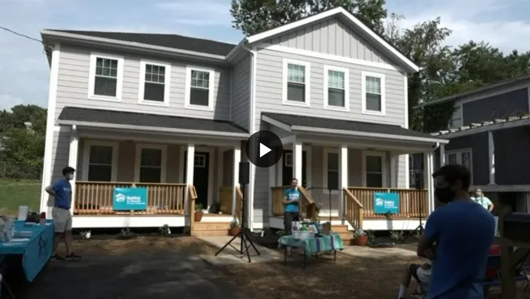 Two families celebrate their new homes