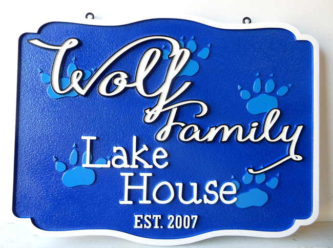 "M22906 - Carved HDU Sign for ""Wolf Family"" Lake House with Wolf Paw Prints"