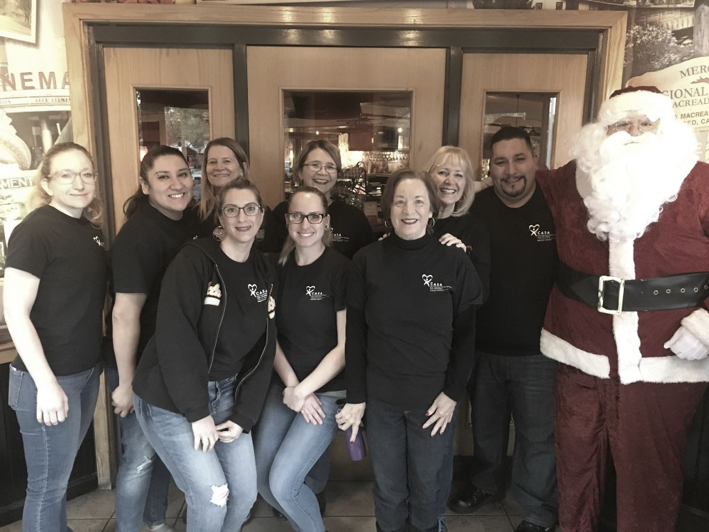 Staff, volunteer & Santa at the event.