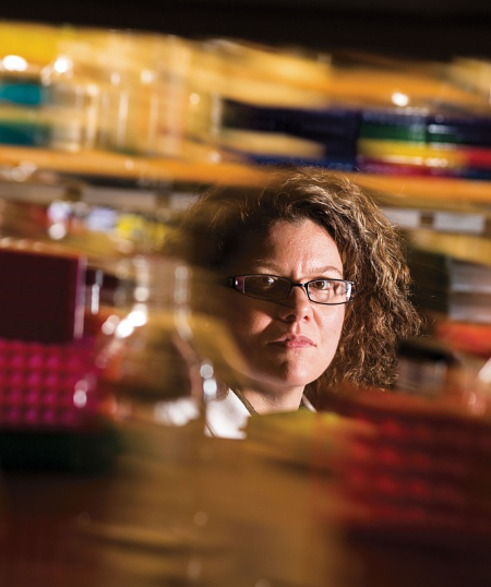 A photo of Dr. Heidi Rehm in the lab