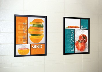 2 food posters in school hallway, food pictures, flip open frames