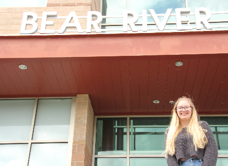 Mary stands in front of Bear River High School