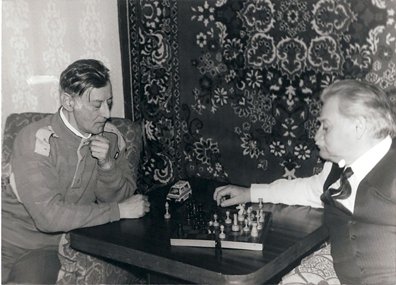 Gregory's father (L) playing chess with Bella's father (R)