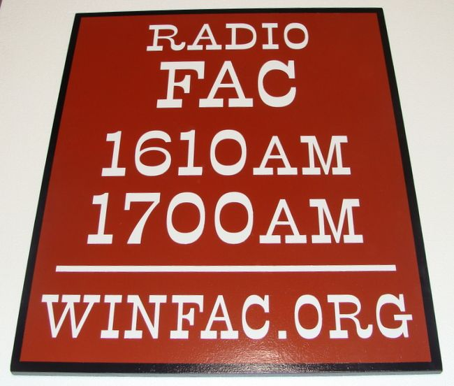 SA28590 - Sign for Radio Station with Radio Frequencies and Website Address