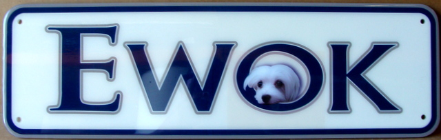 "SA28021 - Carved HDU sign for Pet Store ""Ewok"", with a Dog's Face,"